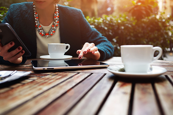 Well-dressed woman real estate agent meeting a client for coffee