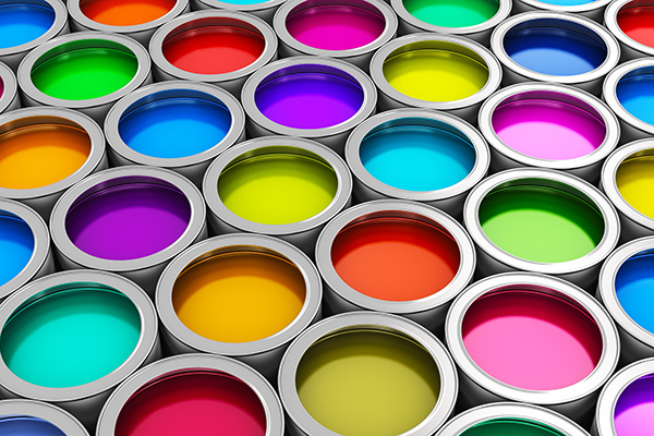 open paint cans featuring a spectrum of bright colors