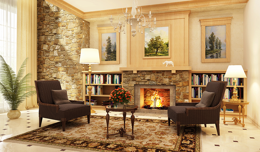 Beautiful living room staged for fall with a fire burning in the fireplace