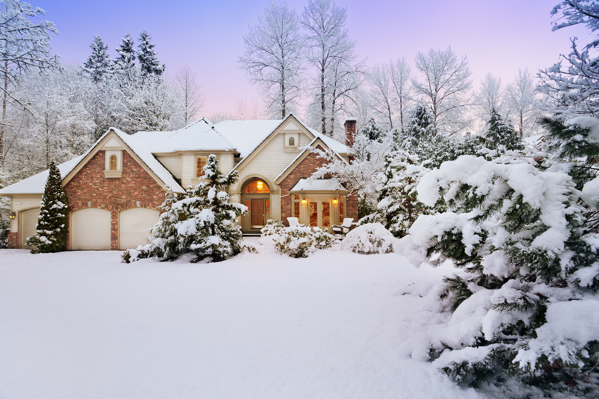 Beautiful, snow-covered home just before sunset