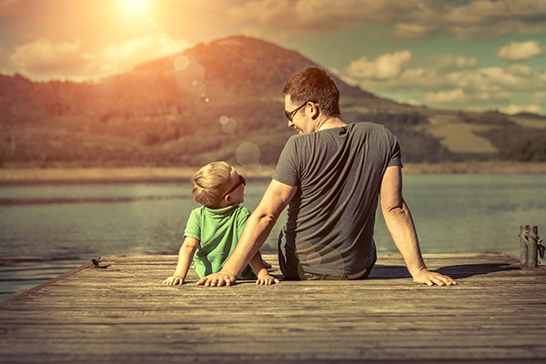 Father and son enjoying quality time together on a beach