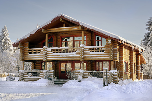 Beautiful log home dusted in winter snow