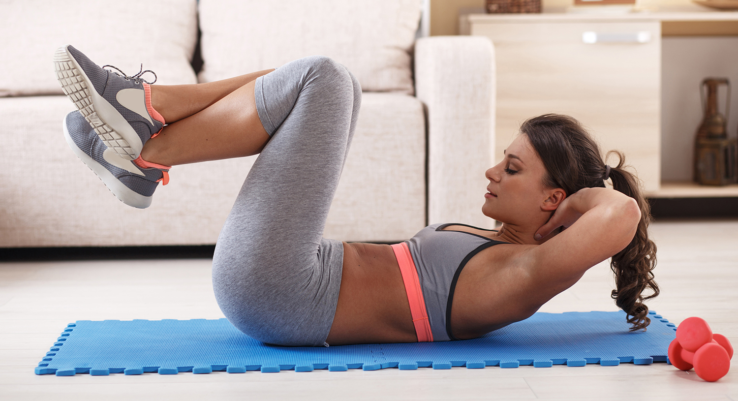 woman doing an ab workout in a home fitness room